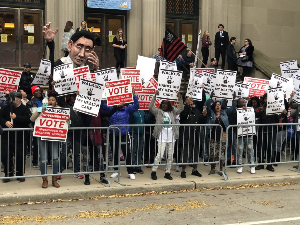 Protesters gathered outside of the Helene Zelazo Center, where a Wisconsin gubernatorial debate was to take place. Photo by Michael Holloway.