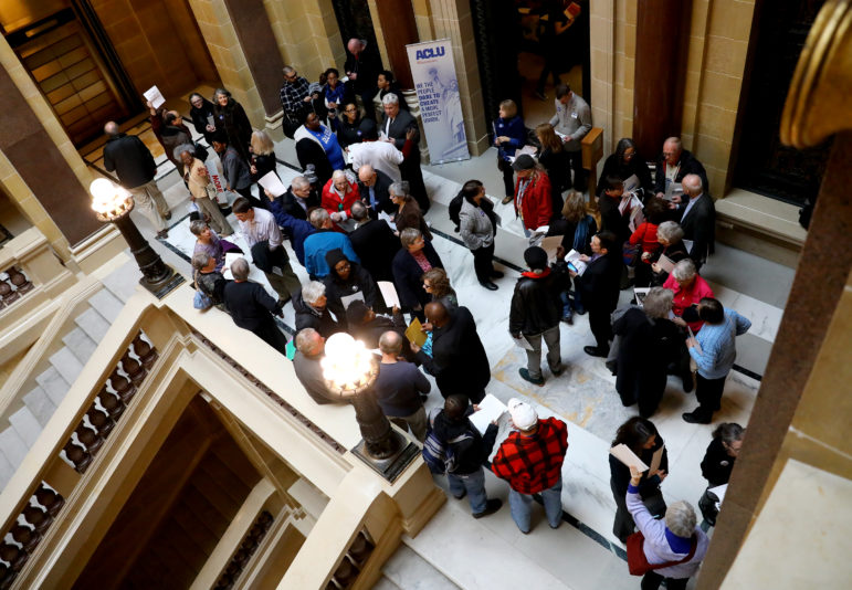 Opponents of a last-minute addition of a $350 million prison to Senate Bill 54 gather on March 13, 2018 at the Wisconsin State Capitol. The group of about 100 citizens met for an information session about the bill and then lobbied senators to vote against it. The bill failed to pass after the Senate declined to take it up. Photo by Coburn Dukehart / Wisconsin Center for Investigative Journalism.