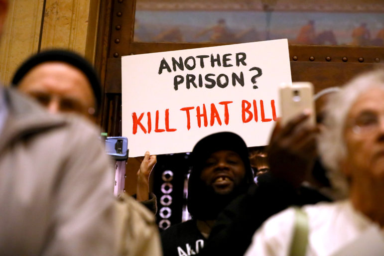 A group of citizens gathers at the Wisconsin State Capitol on March 13, 2018 to protest the inclusion of a $350 million prison on a bill that would have made unrelated changes to Department of Corrections' policy on probation and parole. The prison measure — added after the public hearing — would have resulted in the first new prison in Wisconsin in 17 years. The Senate declined to take up the bill. Photo by Coburn Dukehart / Wisconsin Center for Investigative Journalism.