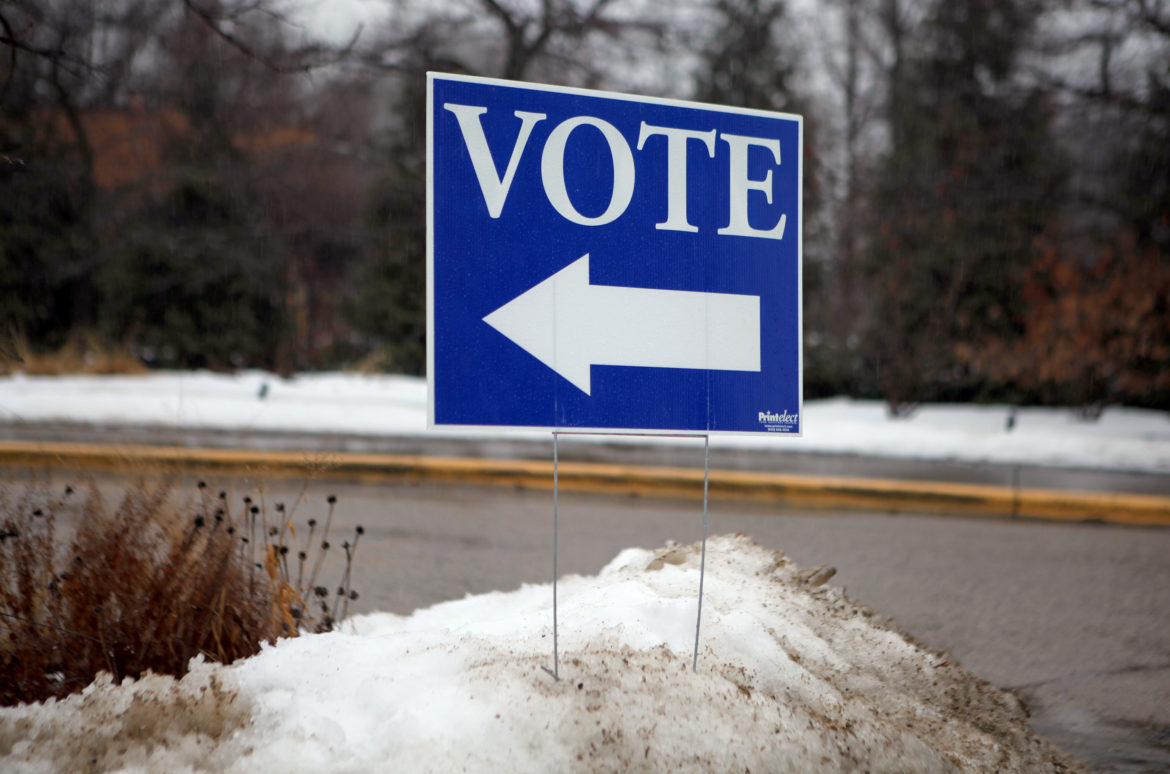 Over the past 13 years, voting has become increasingly difficult for students, the elderly and people of color due to the increase in states requiring voter identification at the polls. There are currently 34 states with voter ID laws, with Wisconsin having one of the strictest in the country. Here, a sign is seen outside the polling place at Olbrich Botanical Gardens in Madison, Wis., on Feb. 20, 2018. Photo by Coburn Dukehart/Wisconsin Center for Investigative Journalism.