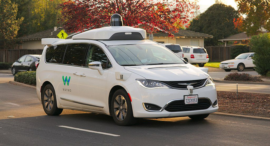 Autonomous Waymo Chrysler Pacifica Hybrid minivan undergoing testing in Los Altos, California. Photo by Dllu [CC BY-SA 4.0 (https://creativecommons.org/licenses/by-sa/4.0)], from Wikimedia Commons.