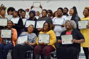 New graduates of a financial education program proudly display their certificates. Photo by Analise Pruni/NNS.