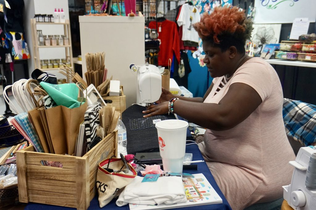 Tiffany Miller sells floral and other accessories at The Bronzeville Collective MKE. Photo by Ryeshia Farmer/NNS.