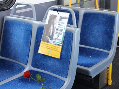 MCTS Honors Rosa Parks with Open Seat and Red Rose on Every Bus