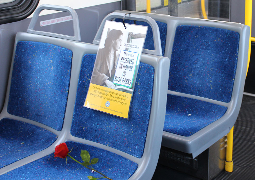 MCTS Honors Rosa Parks with Open Seat and Red Rose on Every Bus. Photo courtesy of MCTS.