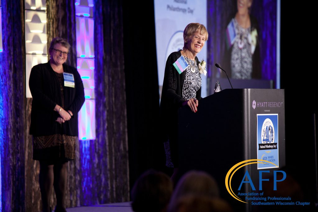 Doris Heiser accepted a special 40th Anniversary Trailblazer Award. AFP board chair, Nancy Seidl Nelson, is on the left. Photo courtesy of the Association of Fundraising Professionals of Southeastern Wisconsin.