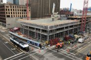 The Hop rolls by the BMO Tower construction site. Photo by Jeramey Jannene.
