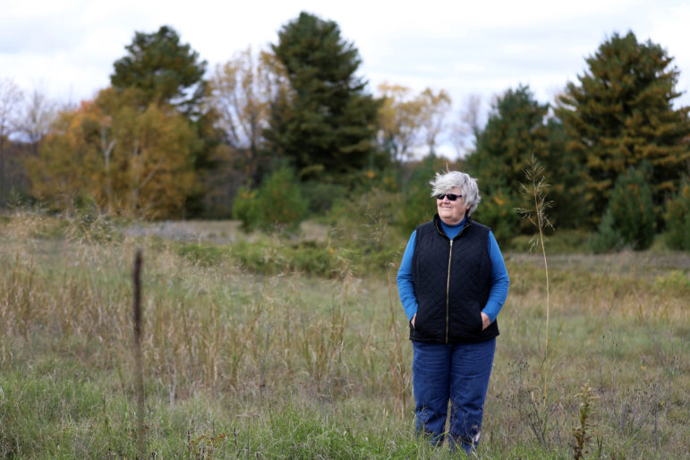"Mary Faydash, co-founder of Friends of the Black River Forest, has been fighting the proposal to build a golf course on and near Wisconsin's Kohler-Andrae State Park for four years. ""What's motivated me is incredible corruption,"" Faydash says. ""Billionaires feel they can run roughshod over not only our rights, but our health."" Photo by Coburn Dukehart / Wisconsin Center for Investigative Journalism."