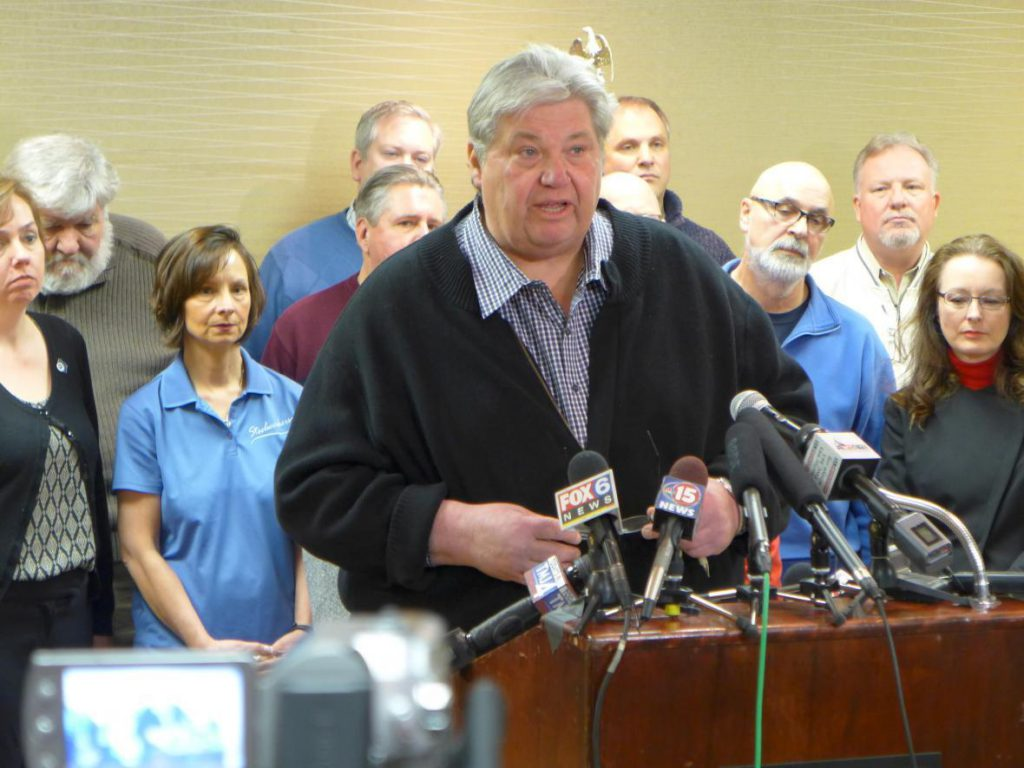 "In this file photo taken Feb. 23, 2016, Phil Neuenfeldt, center, fights the Republican ""right to work"" bill. Neuenfeldt, the longtime former head of the Wisconsin AFL-CIO, died Sunday, Nov. 4, 2018 at his home. Photo by Shawn Johnson/WPR."