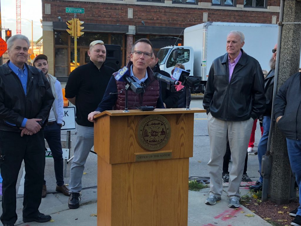 Tony Snell speaks at the 2018 unveiling of the rainbow crosswalks at Cathedral Square Park. File photo by Jeramey Jannene.