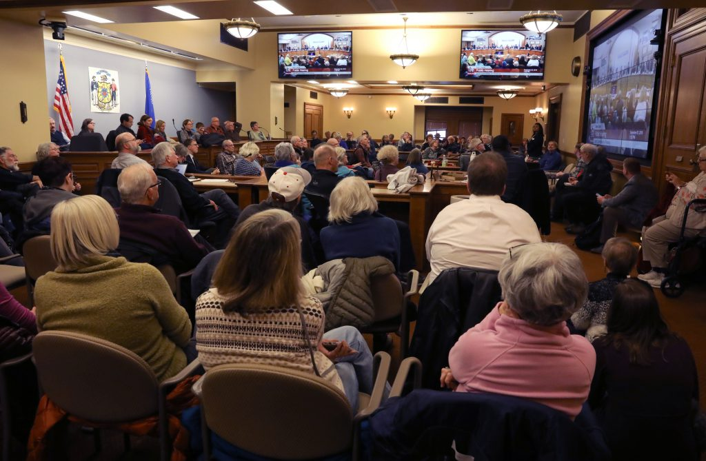 Members of the public occupy an overflow room during the Joint Finance Committee public hearing to discuss bills voted on during an extraordinary session of the Legislature on Dec. 4 and 5, 2018. Photo by Coburn Dukehart/Wisconsin Center for Investigative Journalism.