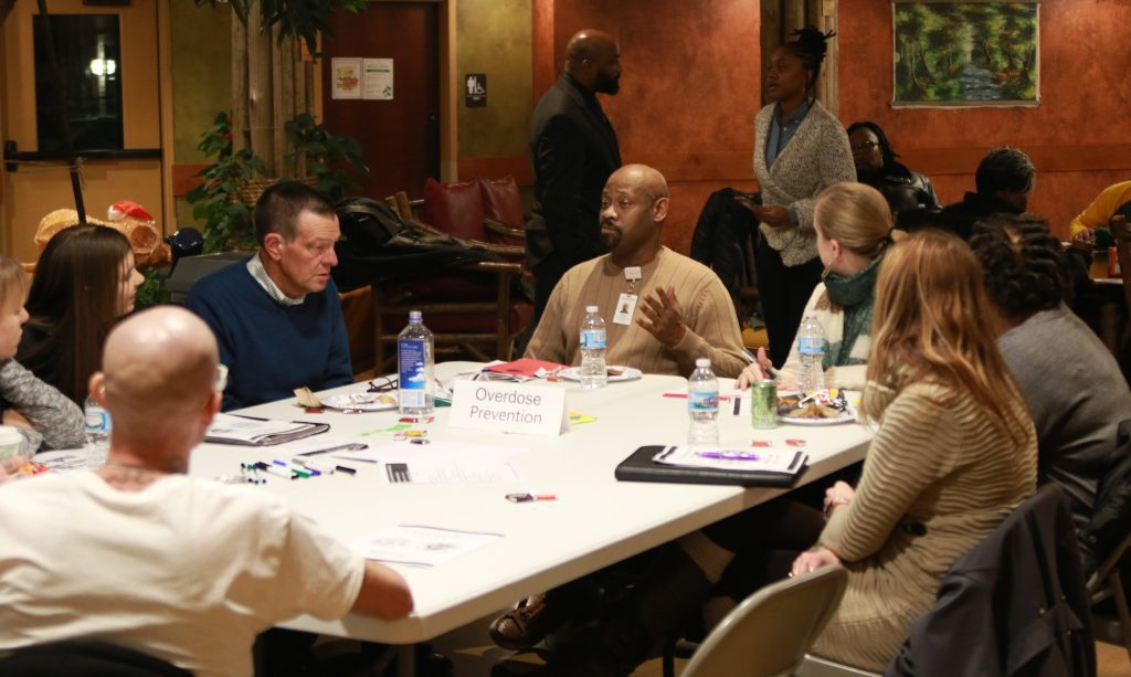 Participants at the City-County Heroin, Opioid and Cocaine Task Force's fourth community engagement session meet in their focus groups. Photo by Max Nawara/NNS.