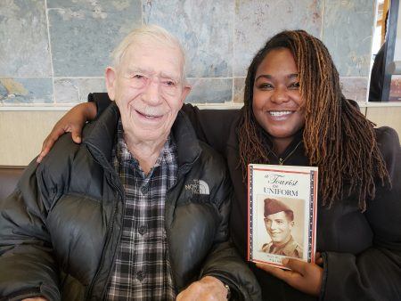 Arthur Schmitz, author and World War II veteran, and Angelique Sharpe, Villard BID Liaison at Havenwoods Economic Development Corp. Photo by Edgar Mendez/NNS.