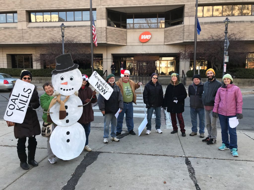 Carolers Deliver Stockings of Coal to We Energies. Photo courtesy of the Clean Power Coalition-Southeast Wisconsin.