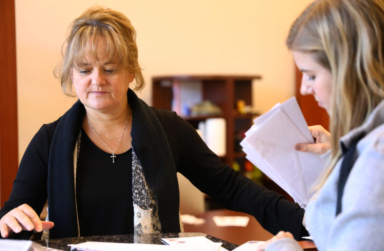 Kathleen Papa is the owner of KPI, Inc., a home health care services business based in Oconomowoc, Wis. She is pictured in her office with Kelly Strong, human resources director, on Nov. 22, 2017. Papa has sued the state of Wisconsin on behalf of home care nurses who are being ordered to repay tens of thousands of dollars for services that were delivered but which the state alleges were not properly documented. Photo by Coburn Dukehart/Wisconsin Center for Investigative Journalism.