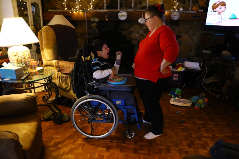 Adrian Strauss laughs while interacting with his personal care worker Bobbie Kasper at his home in Jefferson, Wis., on Nov. 15, 2017. Kasper provides care for him five days a week. Adrian was brain damaged due to abuse as a young child and was adopted by the Strauss family when he was 7. The state's aggressive efforts to crack down on home health care workers who make record keeping errors has prompted some of them to quit, critics say. Photo by Coburn Dukehart / Wisconsin Center for Investigative Journalism.