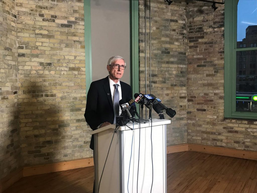 Gov.-elect Tony Evers speaks to reporters Sunday, Dec. 2, 2018 at Ward 4 in Milwaukee, Wis. Photo by Corri Hess/WPR.