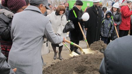 Susan Lloyd (in white coat) participates in a groundbreaking ceremony for the Innovations & Wellness Commons in Lindsay Heights in 2015. Photo by Andrea Waxman/NNS.