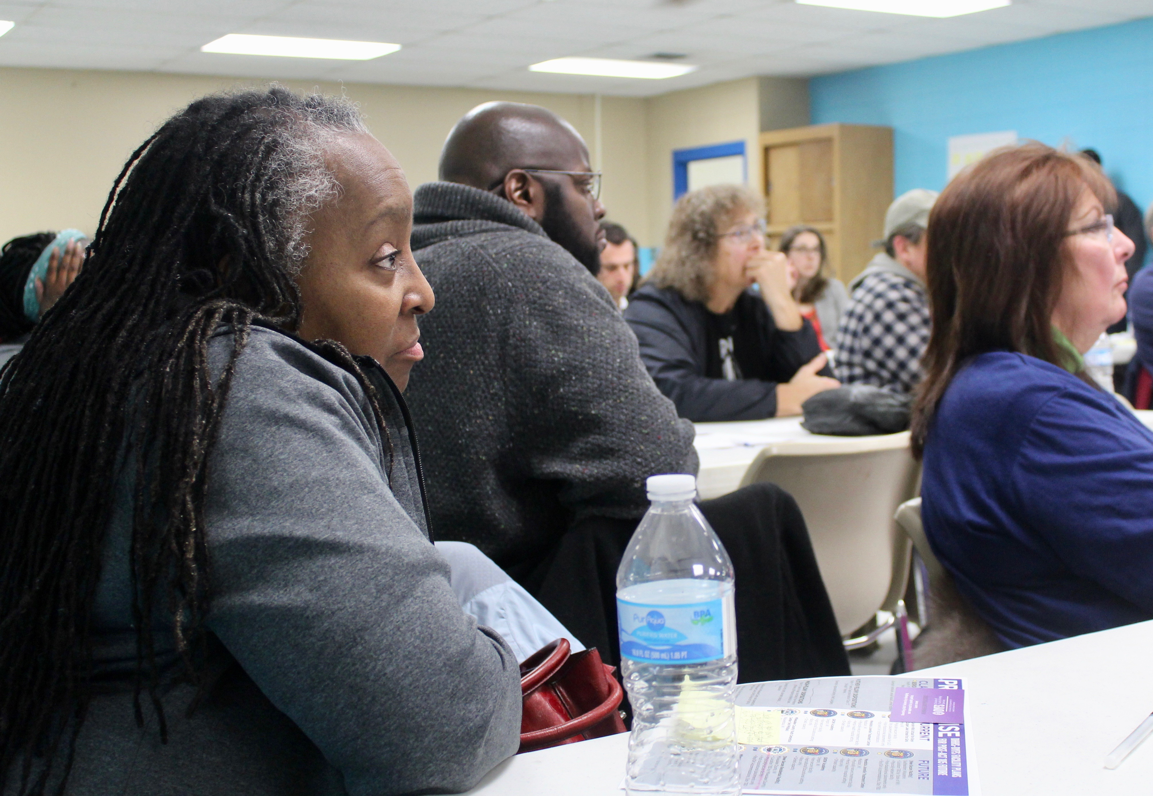 Gwendolyn Bivins, a middle school teacher and Milwaukee County resident, listens to the county's presentation on its newly proposed youth secure residential facility. Photo courtesy of NNS.