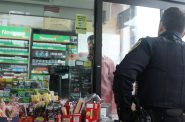 MPD Officer Matthew Diener stops at a corner store in Clarke Square. Photo by Madison Marx/NNS.
