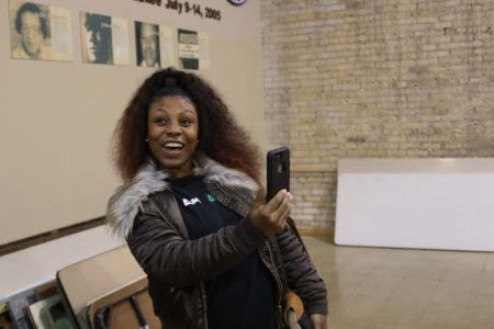Danielle McClendon-Williams, safety chair of Amani United, livestreams Lucas' event on Facebook. Photo by Max Nawara/NNS.