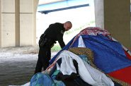 Police officers work to help occupants of homeless encampments. Photo by Carly Wolf/NNS.
