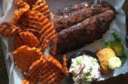 Double B's BBQ Baby Back Ribs, with sweet potato fries on the side. Photo by Cari Taylor-Carlson.