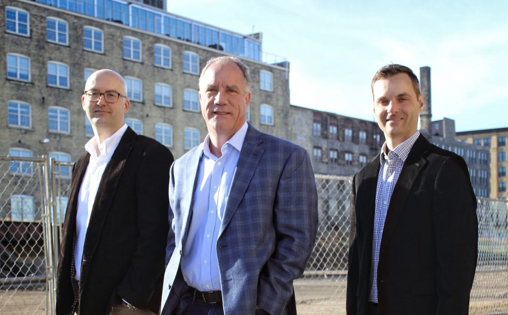 The Walker's Point neighborhood in Milwaukee will be home to raSmith's newest office location. Pictured: Chris Hitch, Tom Mortensen, Luke Haas. Photo courtesy of raSmith.