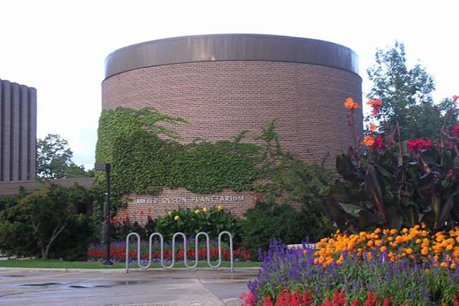 Outside the Manfred Olsen Planetarium. Photo courtesy of UWM via the calendar.