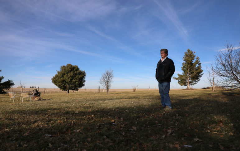 """Alan Jewell looks out across his farmland near Dodgeville, Wis., on Dec. 18, 2018. Jewell has family land next to a proposed solar farm. """"This is an ugly, ugly mark on the land,"""" Jewell says about the proposed 1.2 million solar panels that would be installed. Photo by Emily Hamer / Wisconsin Center for Investigative Journalism."""