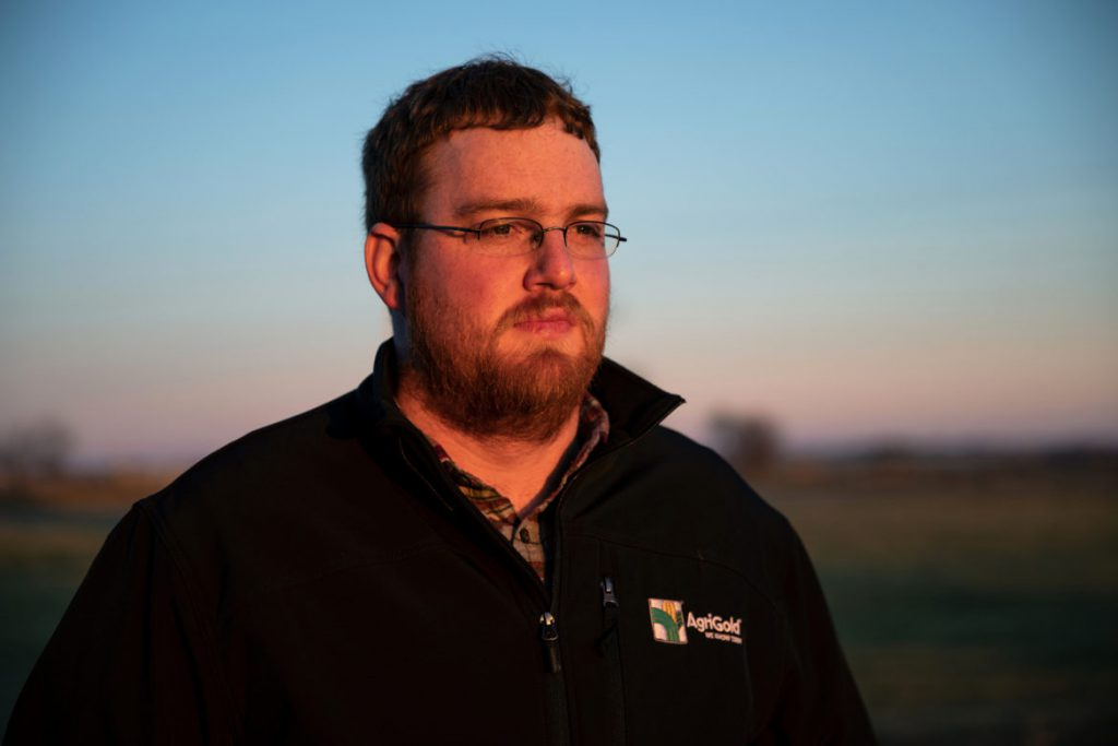 Andrew Bishop, 29, looks out over farmland that could become part of the largest solar farm in the Midwest. The Bishops plan to rent about 650 acres of their land to Invenergy, the company that plans to build the giant solar power project. Bishop says Badger Hollow Solar Farm will help his family's farm stay in business. Here, he is seen outside of the Invenergy office in Cobb, Wis., Dec. 18, 2018. Photo by Emily Hamer/Wisconsin Center for Investigative Journalism.