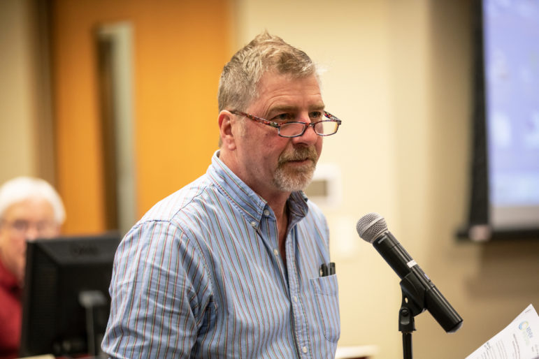 """Michael Vickerman, policy director of the nonprofit Renew Wisconsin, testifies in favor of the Badger Hollow Solar Farm at an Iowa County Board meeting, Dec. 18, 2018. Vickerman says he hopes 2019 will be a """"breakout"""" year for solar in Wisconsin. Photo by Emily Hamer / Wisconsin Center for Investigative Journalism."""