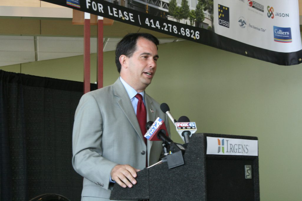 Scott Walker speaking at the 833 East groundbreaking event in downtown Milwaukee in 2014. File photo by Jeramey Jannene.