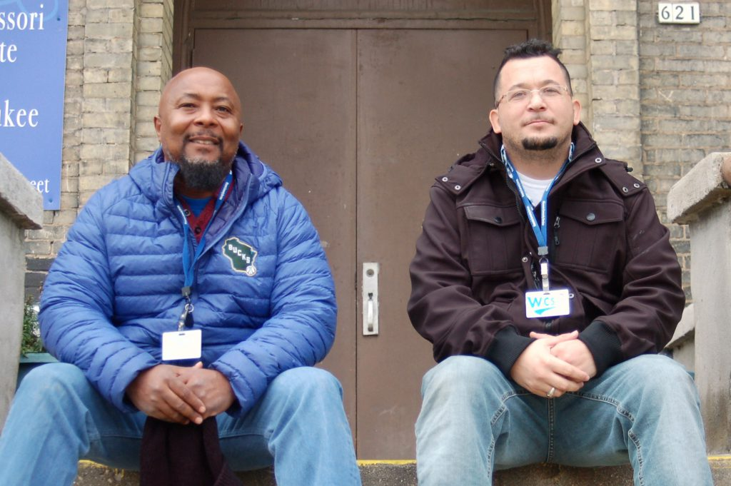 Rodney Campbell (left) and Jose Vasquez sit near the back entrance at the original location of Project Excel, 621 S. 4th St., now the Montessori Institute of Milwaukee. Photo by Edgar Mendez/NNS.