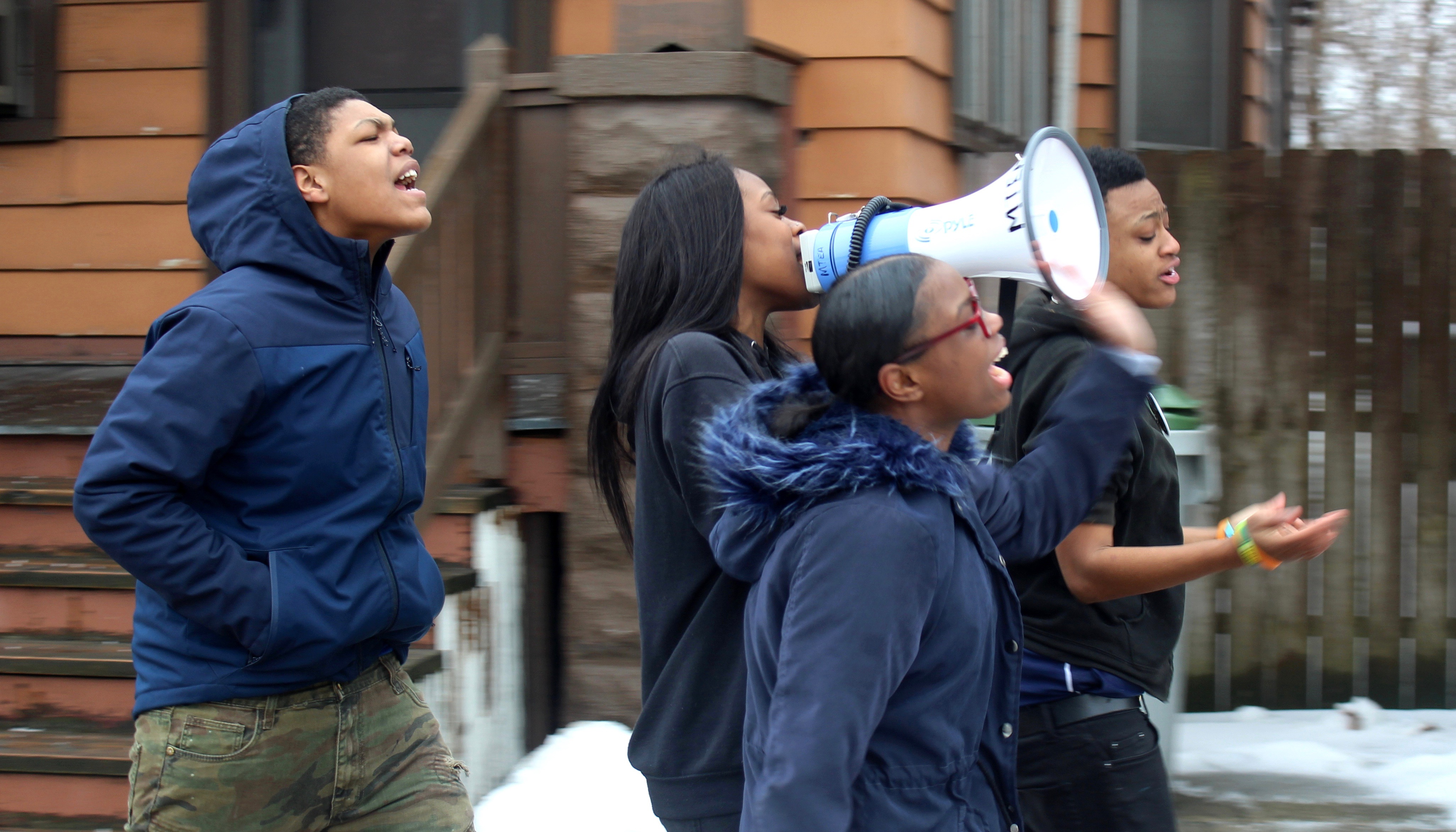 Jashanti Johnson leads the march from the front, shouting chants into the megaphone. Photo by Allison Dikanovic/NNS.