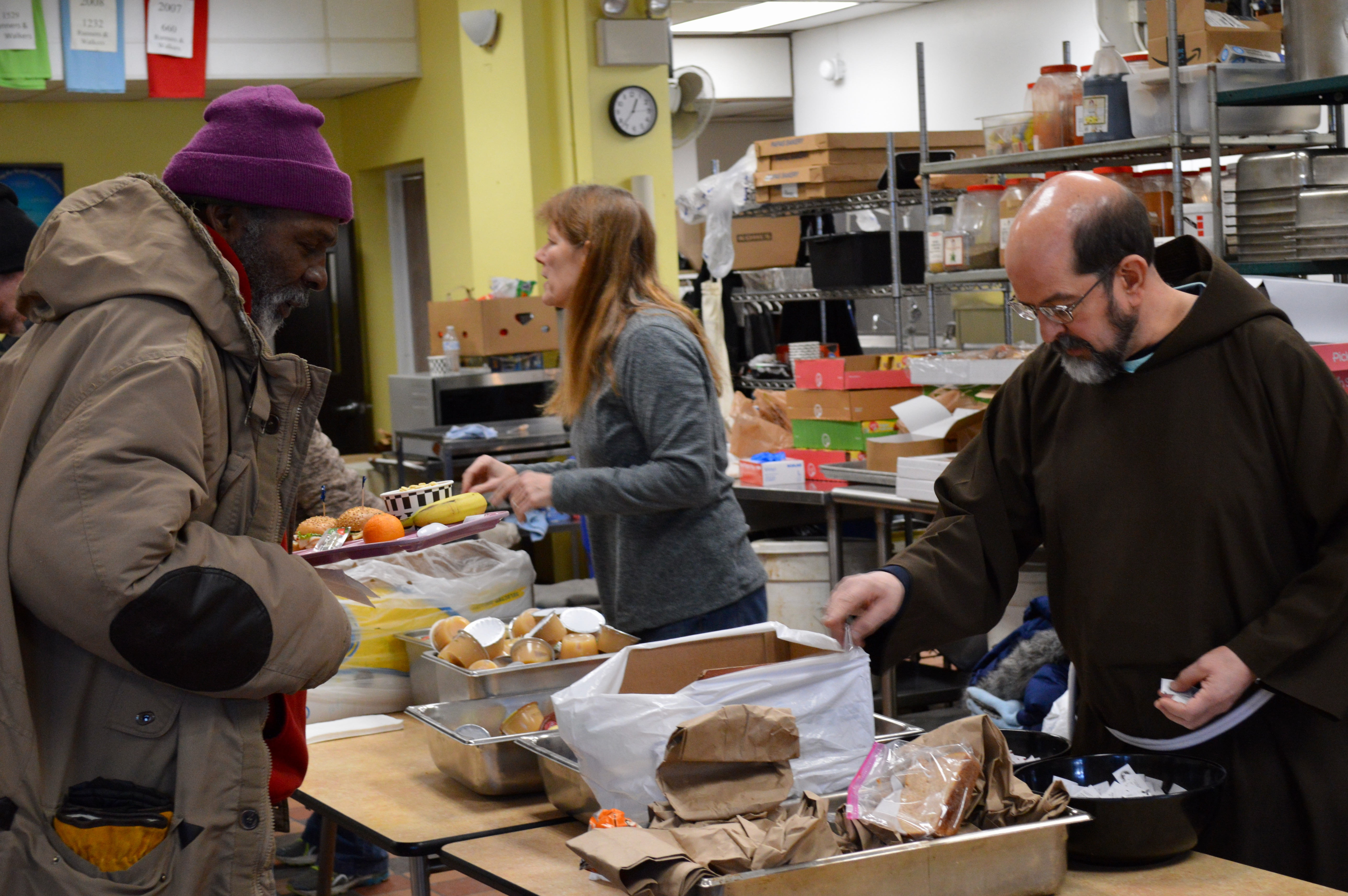 Brother Rob Roemer serves lunch at St. Ben's, which expanded its hours due to Milwaukee's extreme cold. Photo by Ana Martinez-Ortiz/NNS.