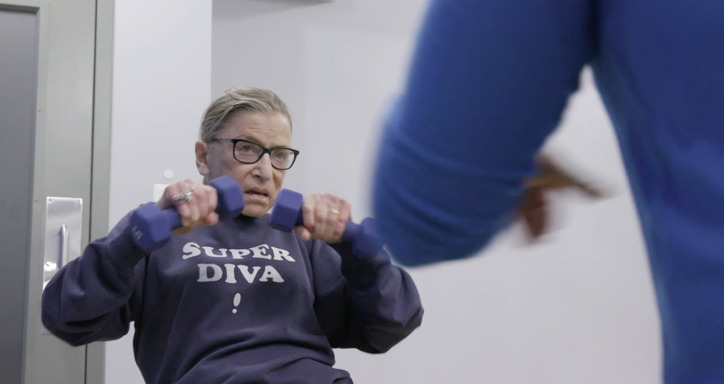 Justice Ginsburg mid workout routine in RBG, a Magnolia Pictures release. Photo courtesy of Magnolia Pictures/CNN Films.