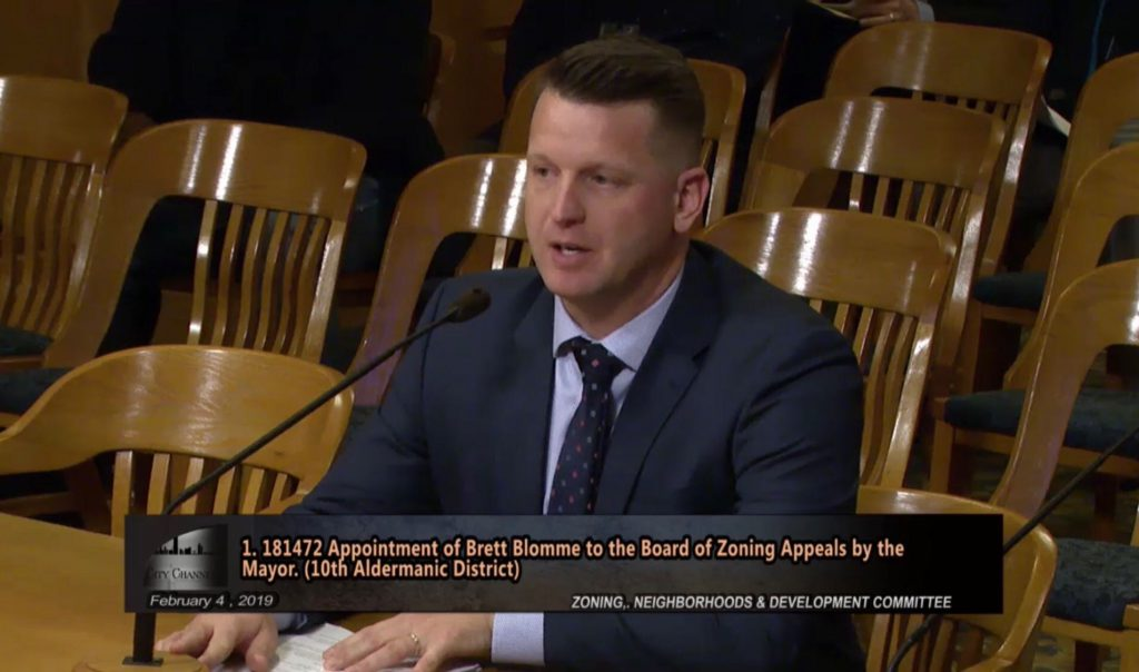 Brett Blomme speaks before the Zoning, Neighborhoods & Development Committee. Image from the City Channel.
