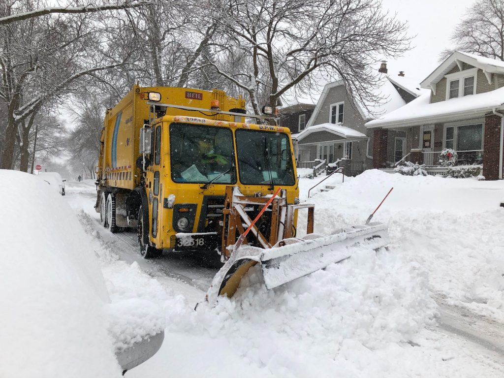 City of Milwaukee truck trying to clear the street. Photo taken February 12th, 2019 by Jeramey Jannene.