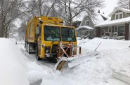City of Milwaukee garbage truck with attached snow plow trying to clear the street. Photo taken February 12th, 2019 by Jeramey Jannene.