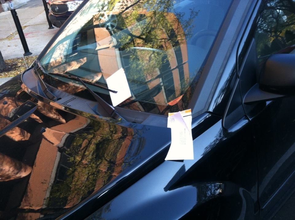 Parking tickets on a car in Milwaukee. Photo from a reader.
