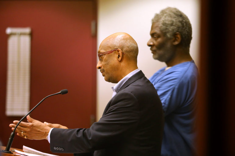 "Assistant state public defender Stanley Woodard represents Ezekiel Golden Jr. as bail is set during initial appearance court at the Dane County Public Safety Building on May 25, 2018. Later that same day, Woodard argued successfully for another client, Eddie Armstrong, to be given a ""second chance"" and released on a signature bond instead of being assigned cash bail. Photo by Coburn Dukehart / Wisconsin Center for Investigative Journalism."