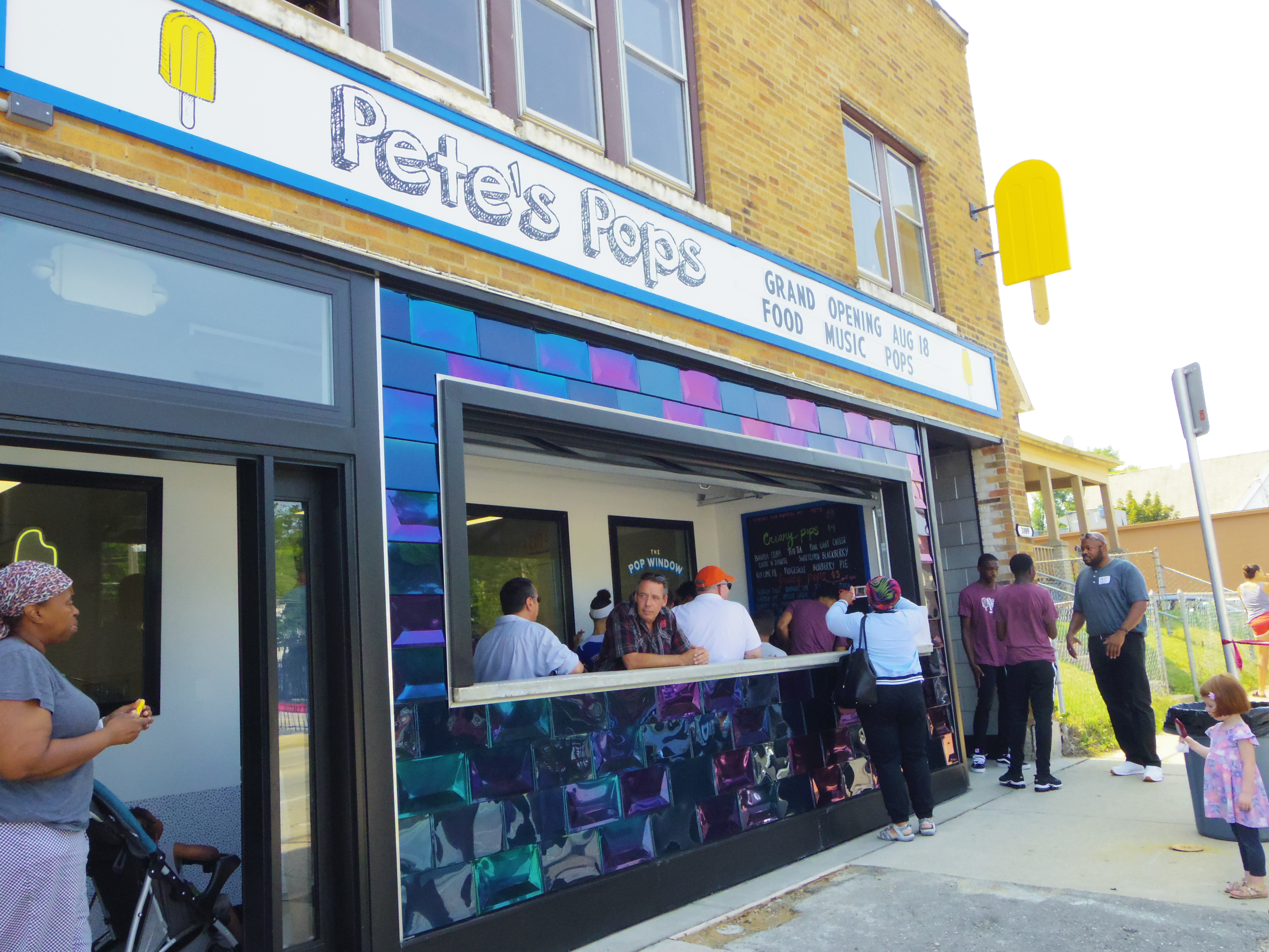 Community members gather for the grand opening of the new Pete's Pops storefront on the Near West Side. Owner Pete Cooney had been selling his popsicles for three summers when he heard about the inaugural Rev-Up Milwaukee small business competition. Photo by Robyn Di Giacinto/NNS.