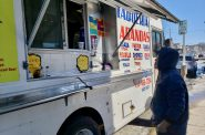 A customer waits for his food at Taqueria Arandas taco truck. Photo by Edgar Mendez/NNS.