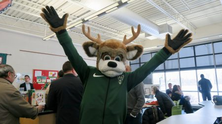 Bango greets MANDI judges for a site visit at the multi-sport complex at Browning Elementary School. Photo by Cynthia Crawford/NNS.