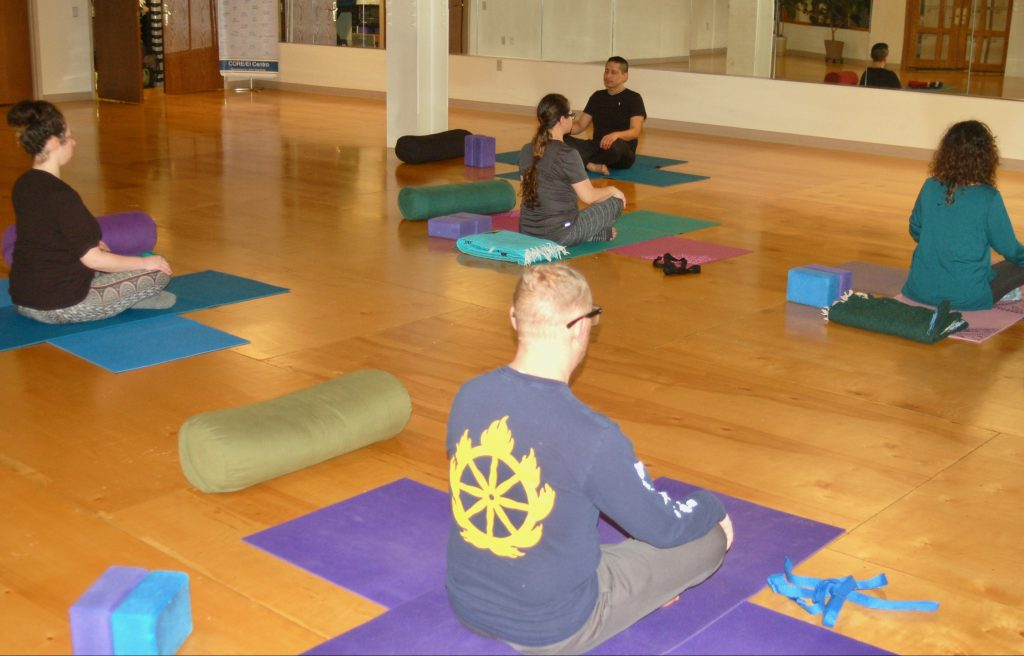 CORE El Centro clients sit in a yoga pose during a recent class. Photo by Edgar Mendez/NNS.