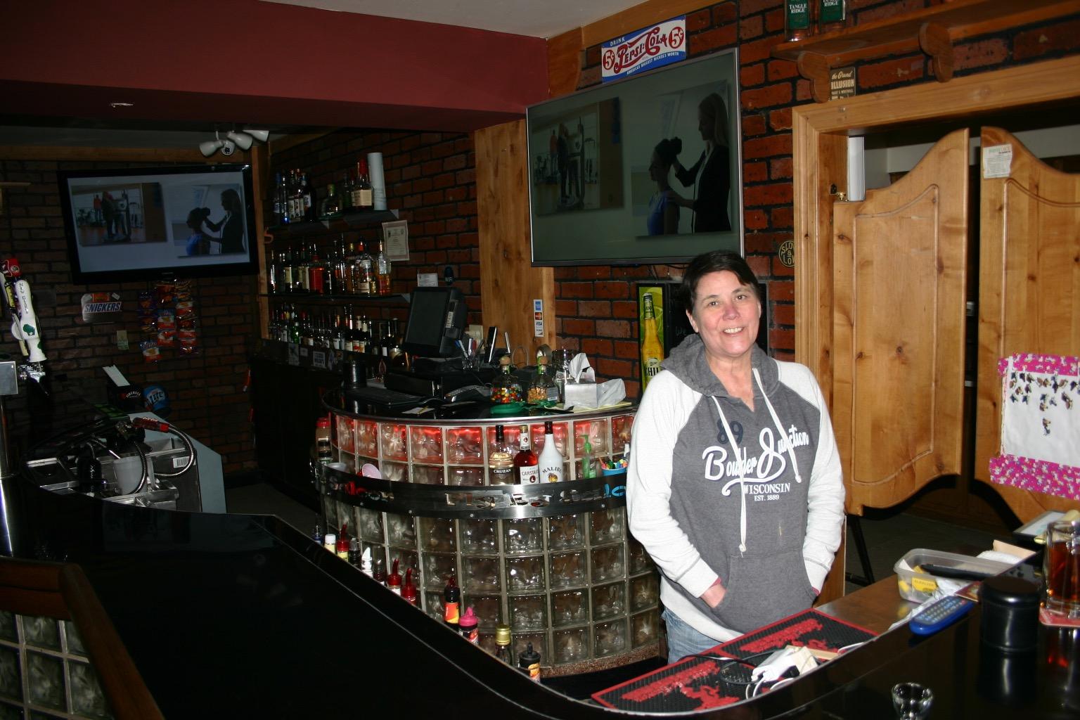 Debbie Dean behind the bar at Neighborhood Bar. Photo courtesy of Warren Johnston.