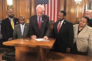 Mayor Barrett signs the resolution approving the deal with the DNC. Photo by Jeramey Jannene.