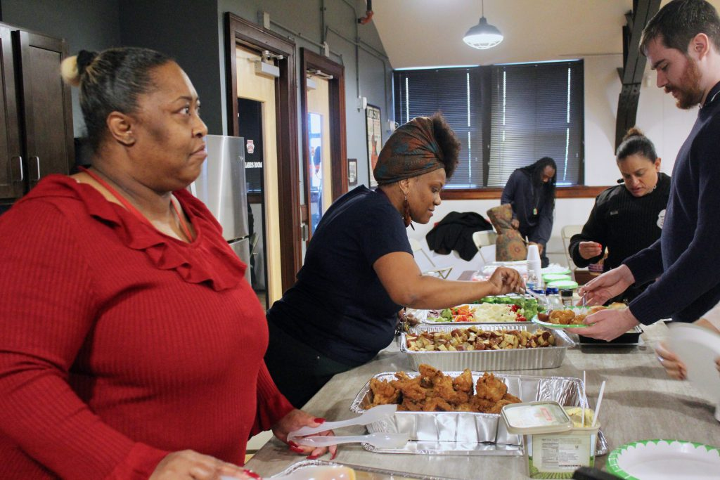 Janet Robinson (left) serves a family-style dinner at the welcome home ceremony. (Photo by Allison Dikanovic)