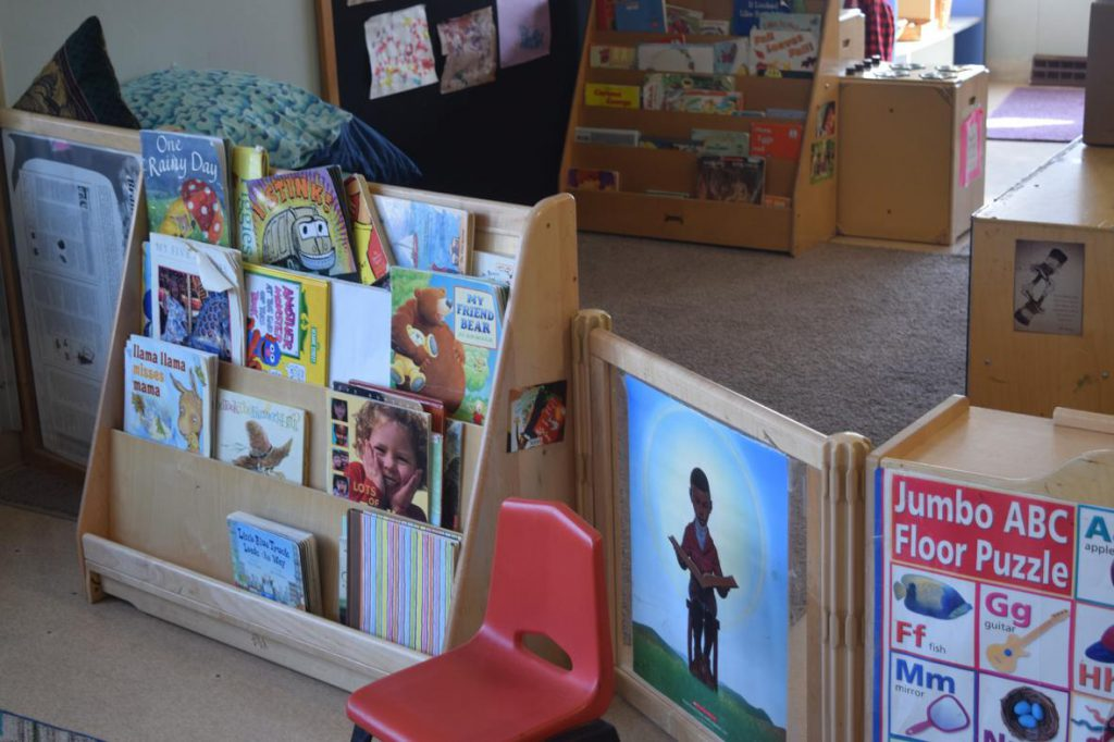A book shelf in the older toddler classroom, where children learn through a play- and inquiry-based curriculum at Saint Mary's Hospital Child Care Center. Photo by Phoebe Petrovic/WPR.